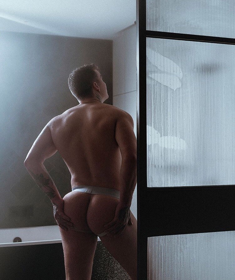 His hands cup his perfect round, jock-framed ass!