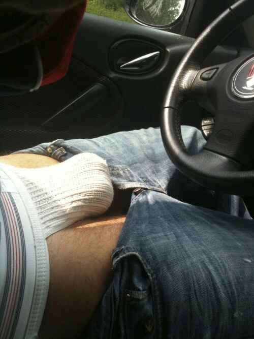 Waiting at the park-and-ride with a jock full of nuts and cock. Feels great with the sunshine on them like a spotlight!